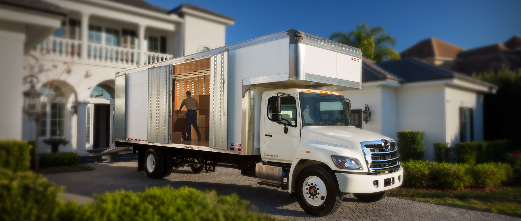 Dry Freight Furniture Mover unloading boxes at a home