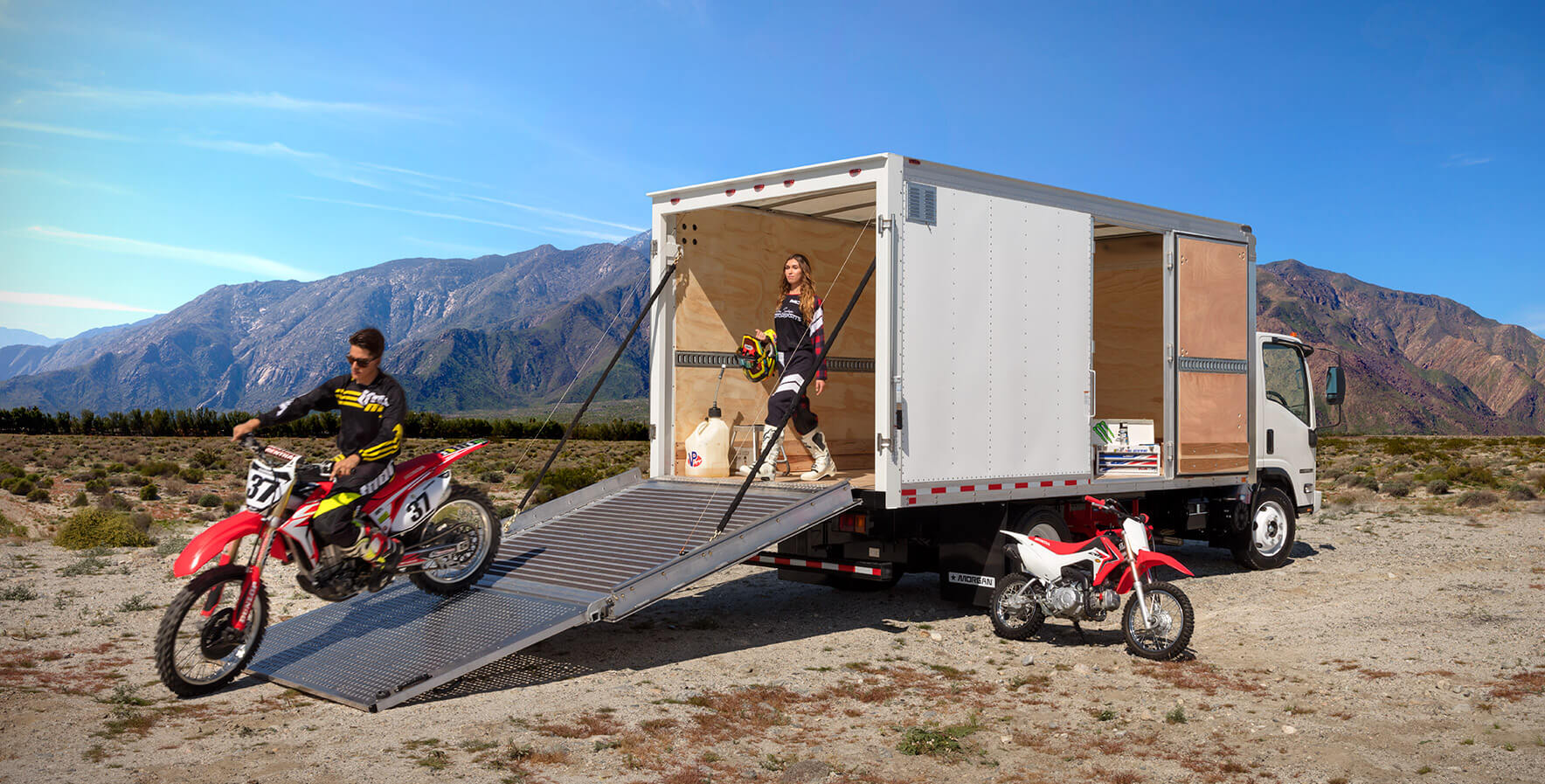 Dry Freight Proscape-Van driving motorcycle down the Proscape-Van ramp